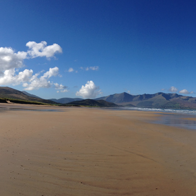 blue sky and mountains and a golden sand beach Brandon Bay Dingle Peninsula