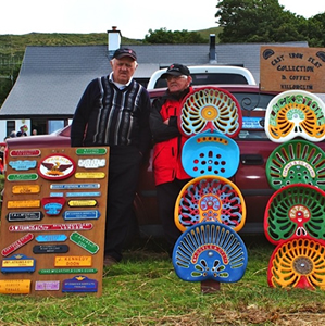 Two men at Camp Rally Dingle with colourful tractor seats
